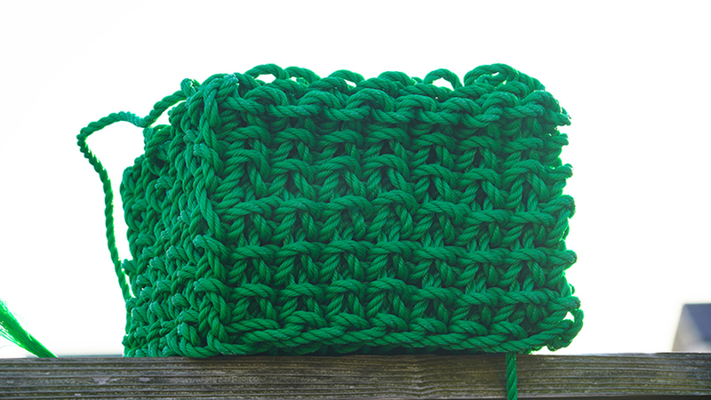 A cube made from green thread - Solid Knitting